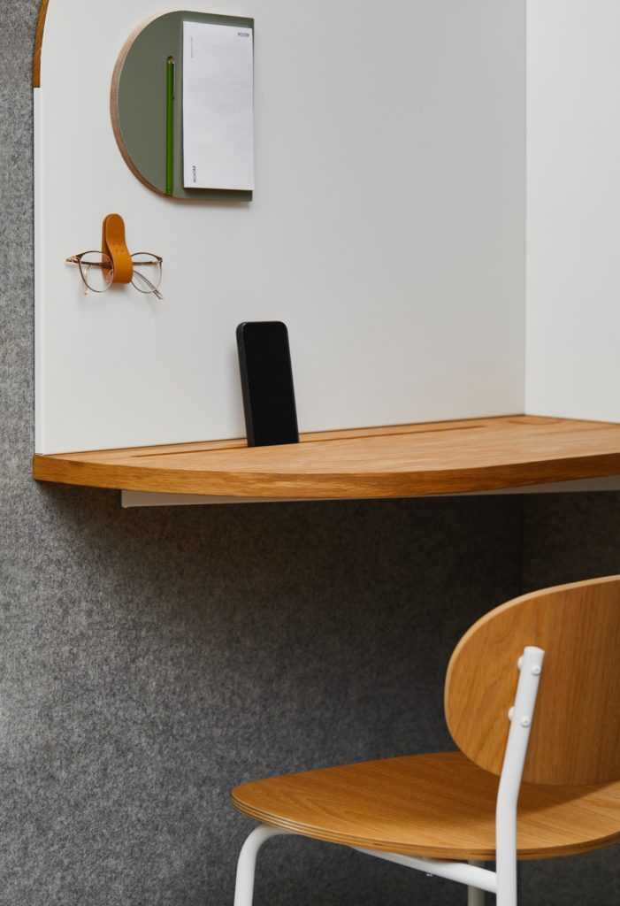 Desk with phone propped up.